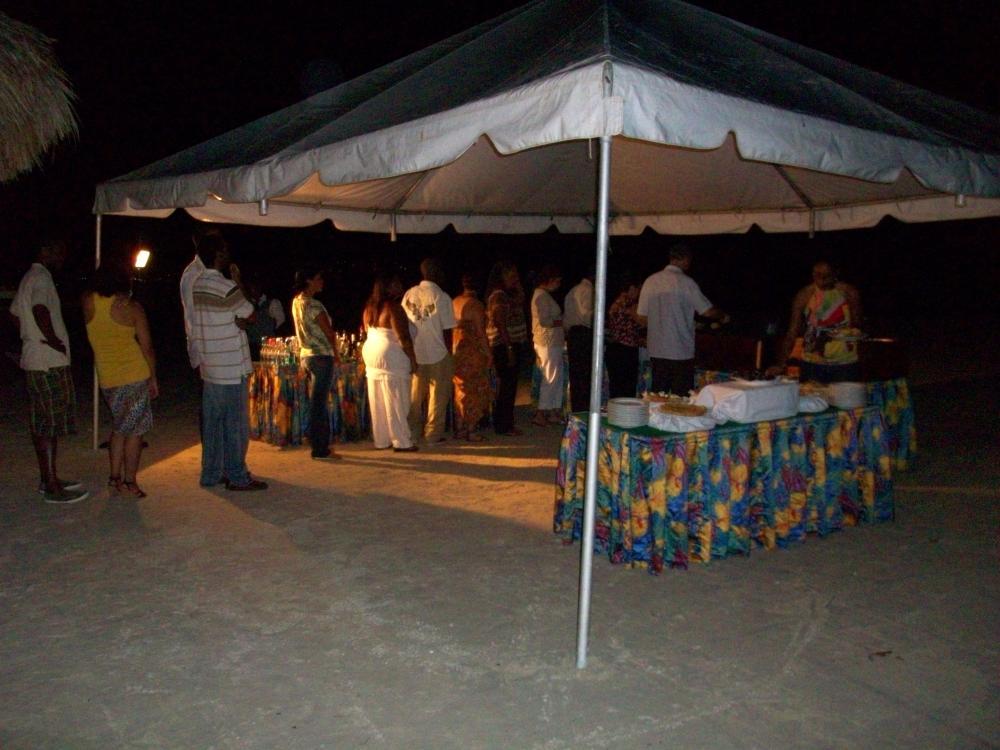 The rehearsal dinner buffet on the beach.