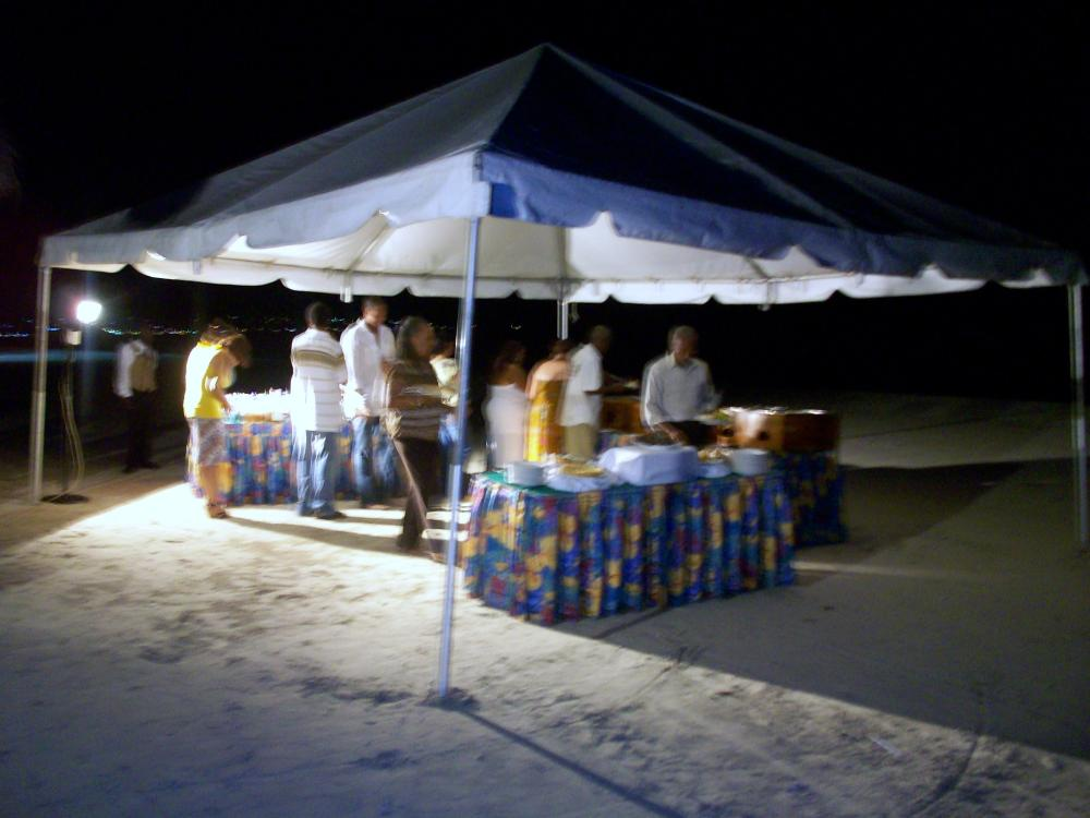The rehearsal dinner buffet was under a tent.