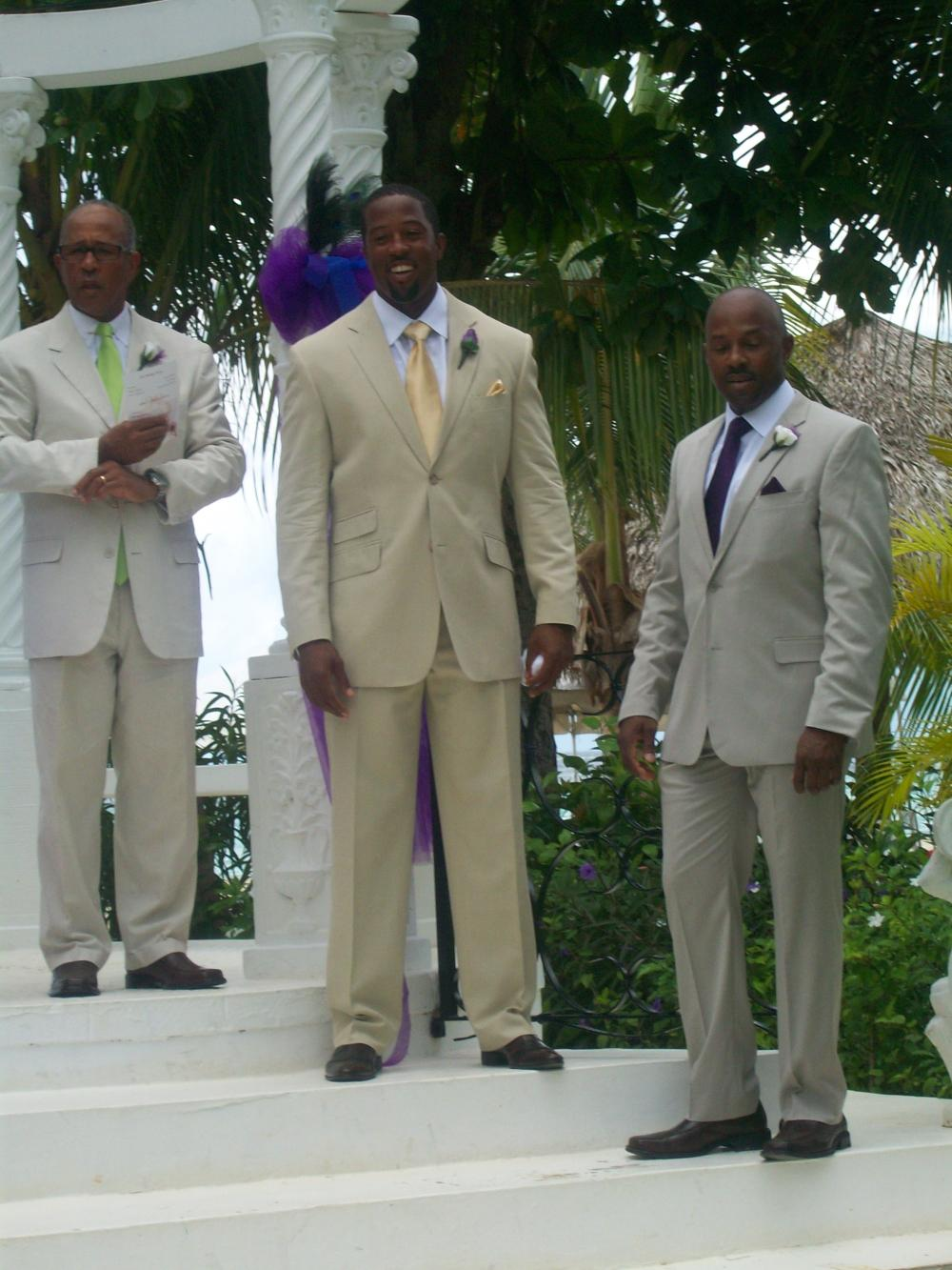 The groom, minister and best man waiting for Cynthia to enter.