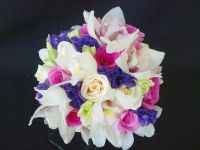 white cymbidium orchids and purple lisianthus with fyusha roses and ivory roses bouquet