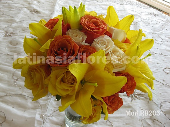 yellow lilies with orange roses and ivory roses bouquet