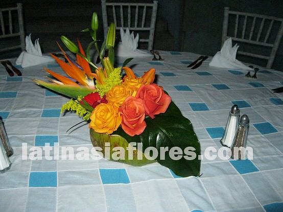 colorful centerpiece in a coconut as a vase