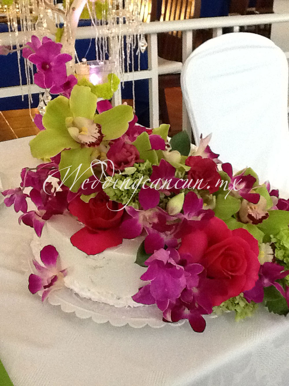 Beautiful combination of green, fucsia and purple flowers. A deluxe cake!