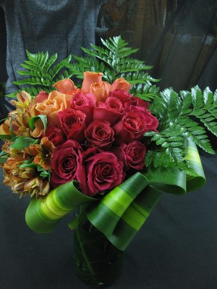 red roses and orange roses with orange alstroemeria wedding centerpiece