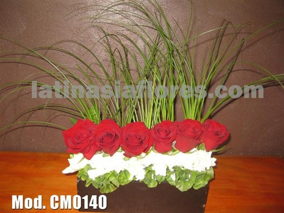 red roses and white carnations centerpiece