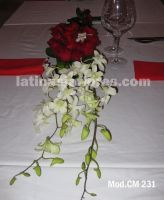 red roses and white dendrobium orchid wedding centerpiece