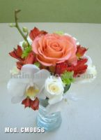 white phaleanopsis orchid with red alstroemeria and pink roses wedding centerpiece