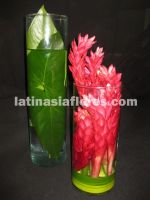 tropical centerpiece. Red ginger and foliage