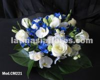 white phaleanopsis orchid with ivory roses and blue alstroemeria wedding centerpiece
