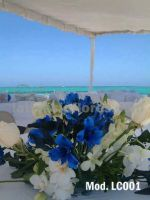 blue alstroemeria and white orchids wedding centerpiece