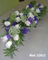 ivory roses and purple lisianthus wedding centerpiece