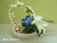 blue roses with white drndrobium orchid and white oriental lily wedding centerpiece