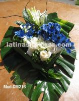 blue alstroemeria and white roses with casablanca lilies wedding centerpiece