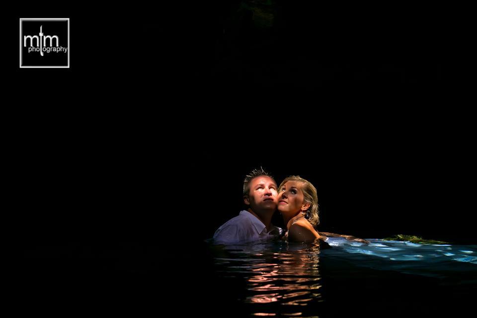 * Cenote couple bask in sunbeam