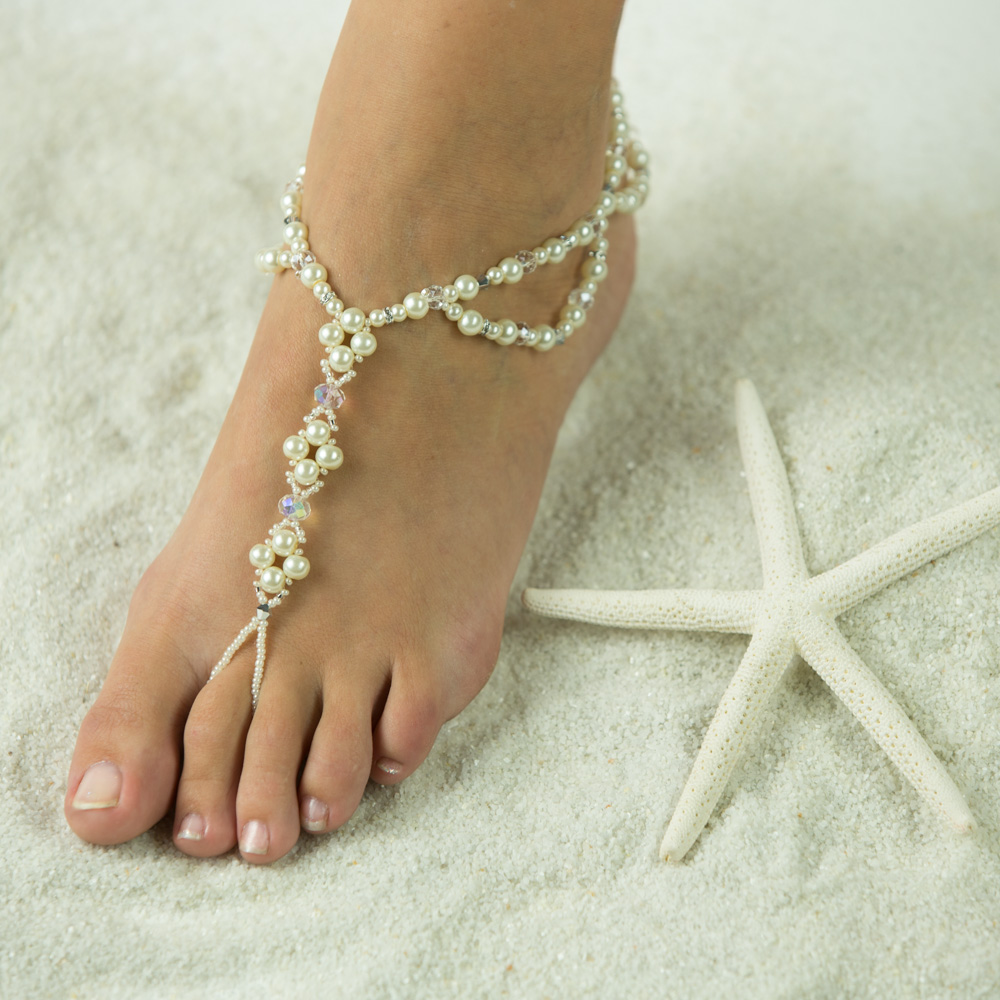 $69.95 This Bridal Jewelry that will turn heads. Barefoot sandals makes a wonderful gift for her. Custom made Foot Jewelry in white, ivory, Red, Blue, Purple or your wedding theme colors. Handmade with Pearl Bead, clear and silver Sparkling Crystals. Dest