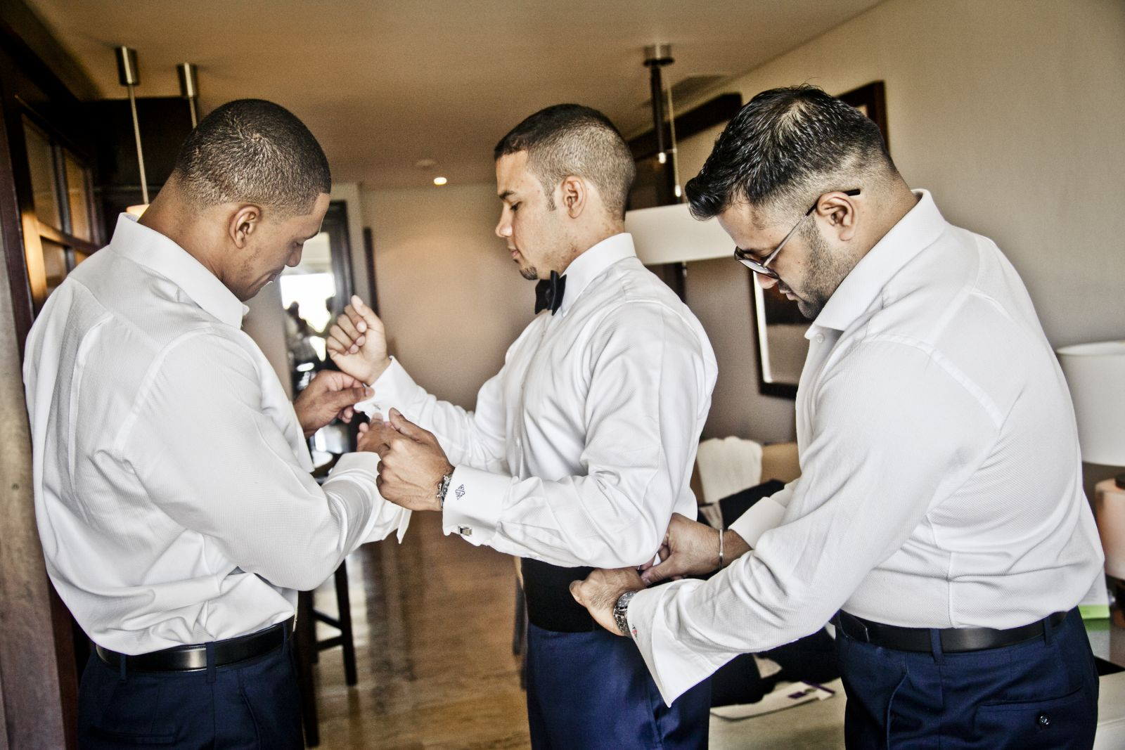 His groomsmen getting him ready