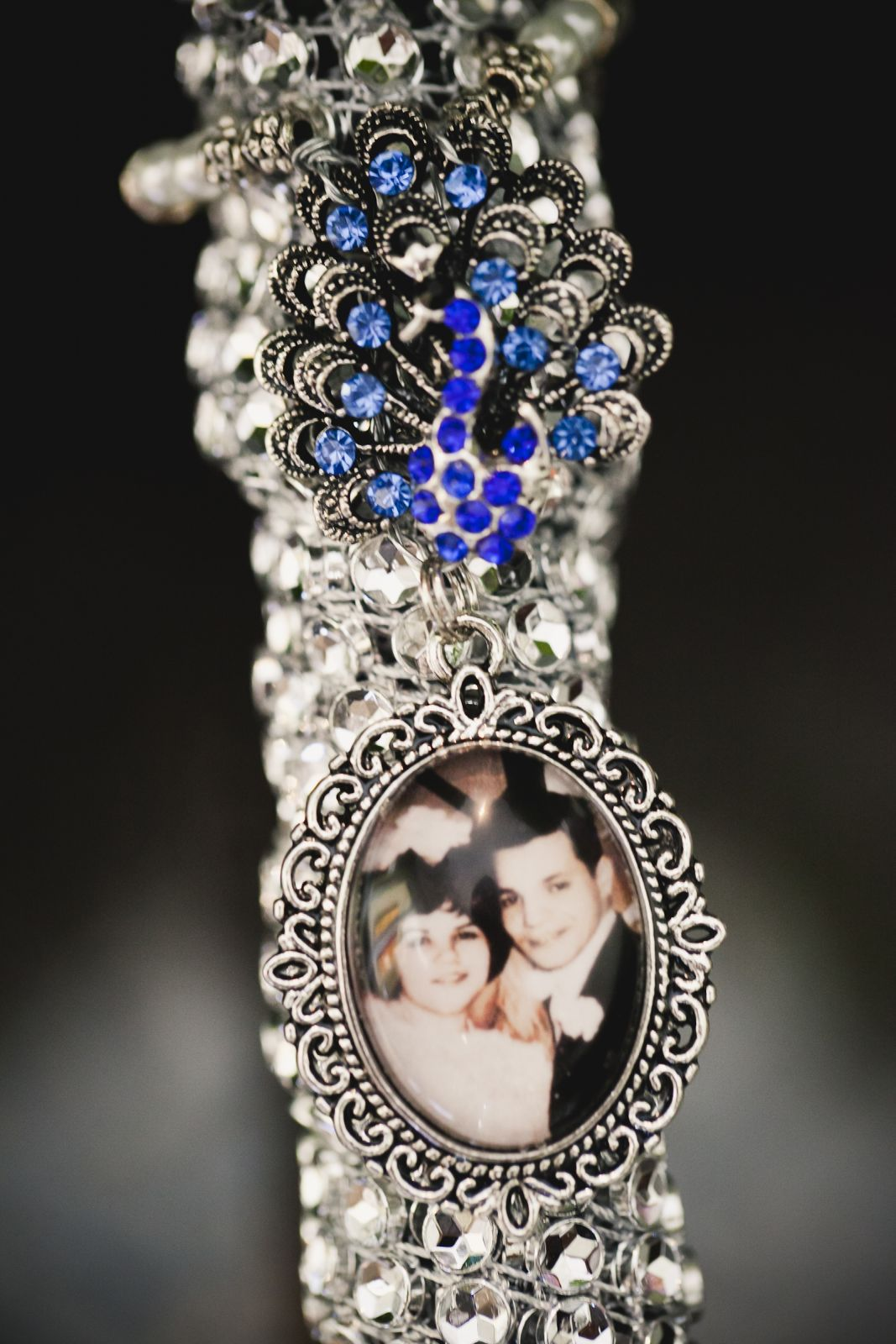 My something old- my grandparents wedding picture in a peacock charm hanging from my bouquet