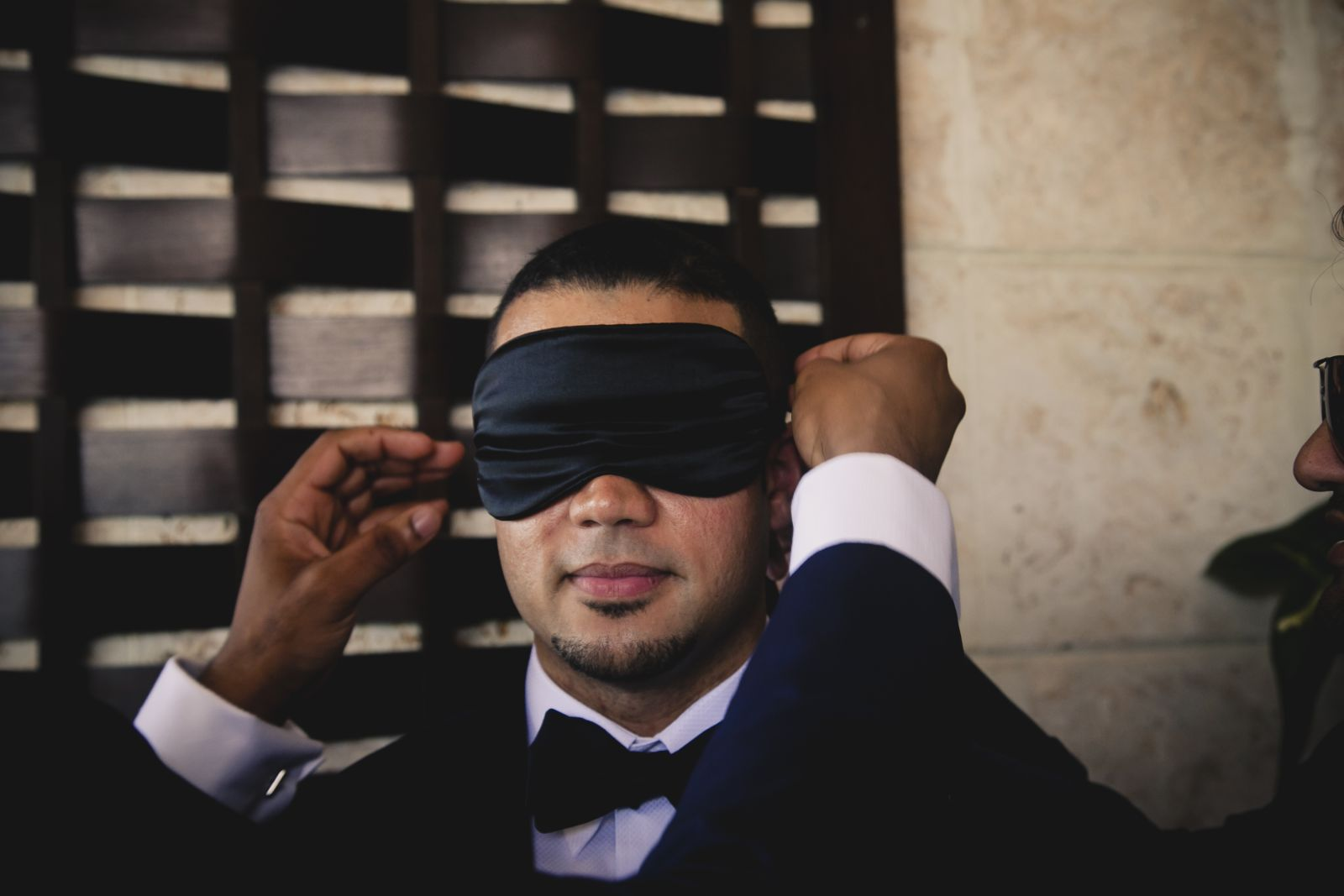 Blindfolded groom