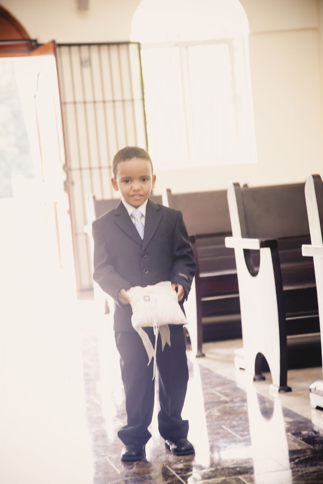 Ring bearer- and yes, he walked half way in, found his parents and sat with them instead of going all the way down lol
