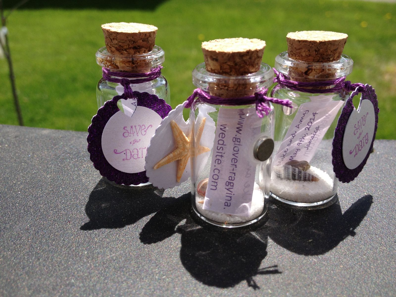 "Completed Message-in-a-bottle Save-the-dates with magnets, appox 1.5"" tall."