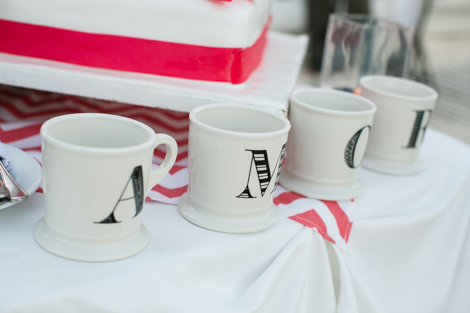 """cake table; I purchased the mugs (that spell """"amor"""") from Anthropologie and took them with me."""