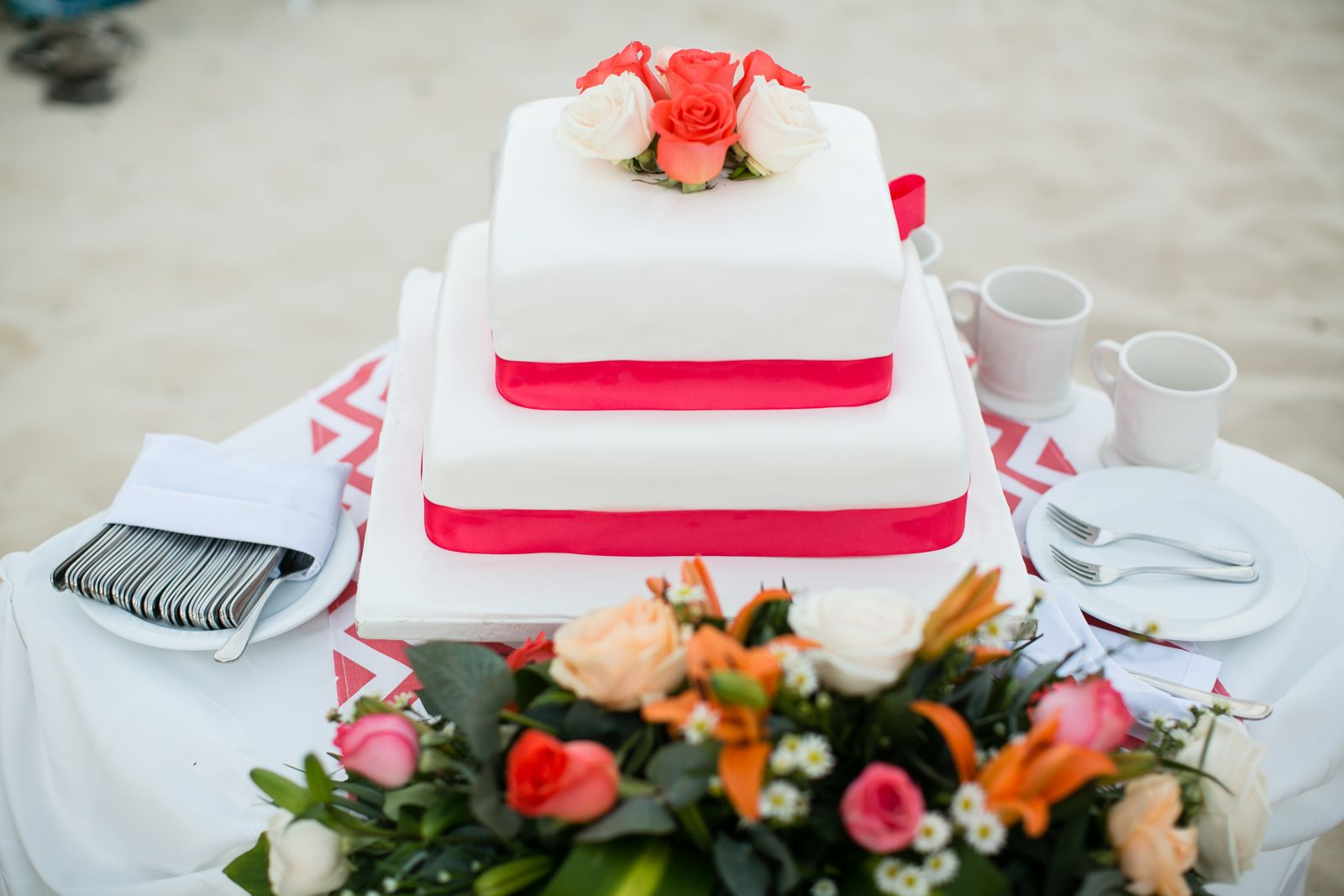 wedding cake made by The Royal, was an upgraded size that came with our wedding package. I was able to request the coral ribbon and coral roses for the top. The long floral arrangement on the table was a free surprise addition made by The Royal and put ou