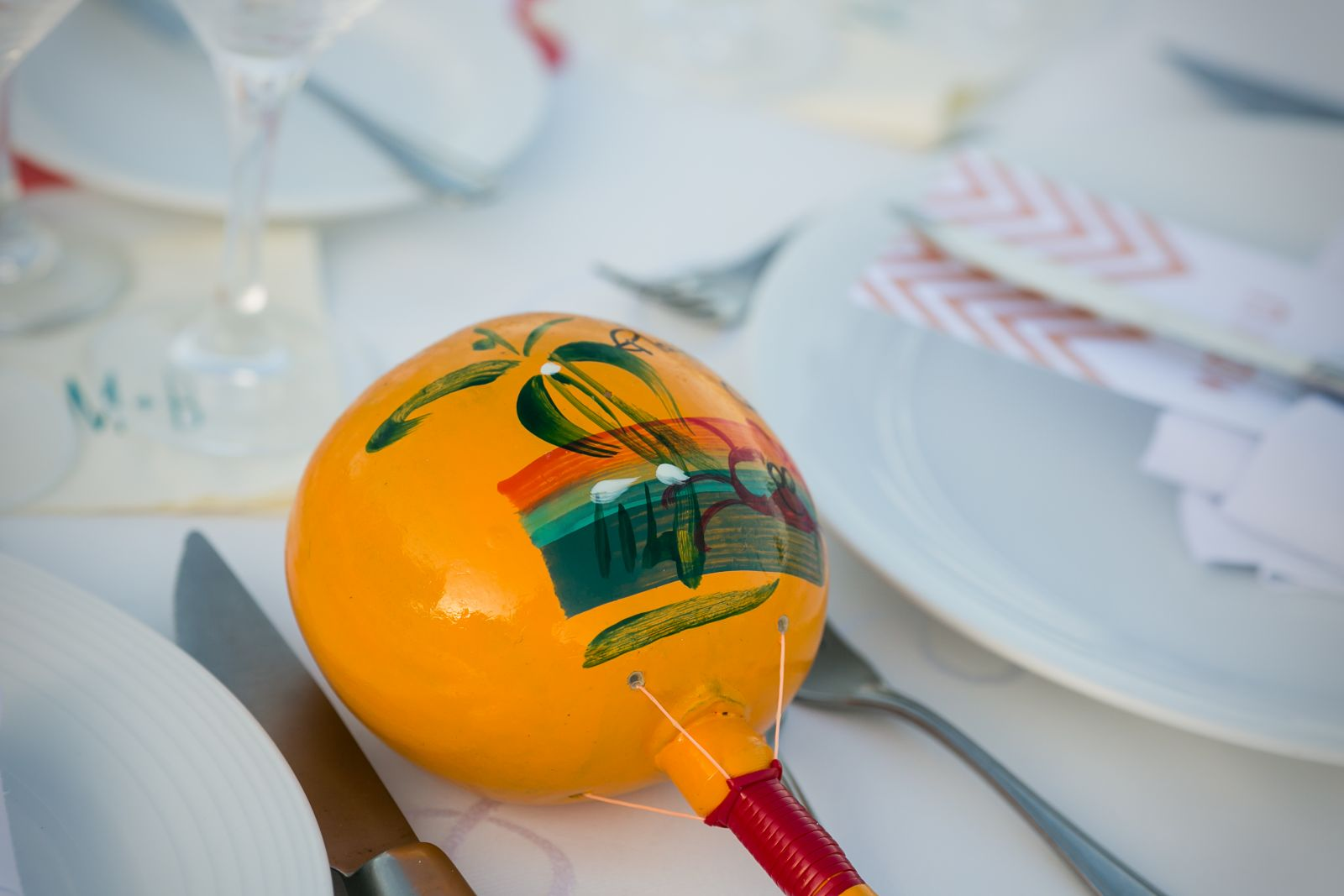We bought the wooden maracas on 5th Ave. in Playa, and used them as our wedding favors - we put one out at each place setting.