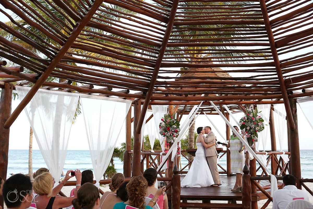 Newlyweds! Kiss under the gazebo