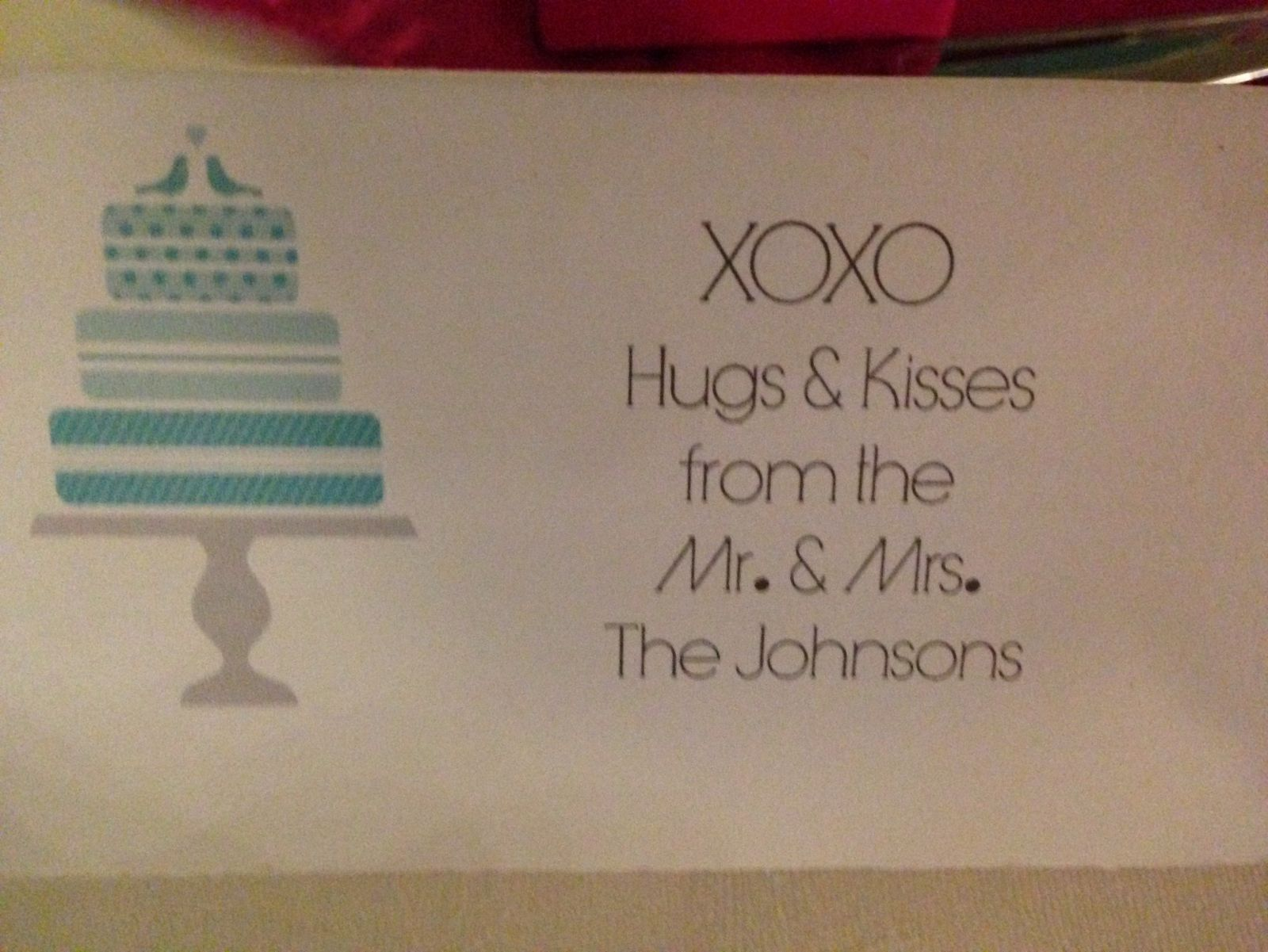 Side 1 Of TTent tag In front Of favor Box filled with Hershey's hugs And kisses   pink And turquoise foil