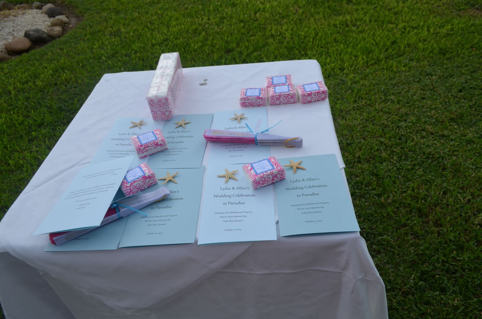 Table with Silk fans, tissues And wedding programs