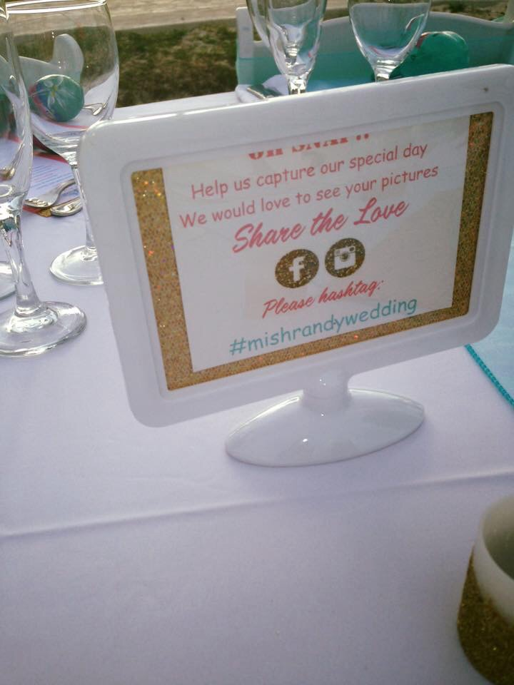 My DIY hashtag photo signs had on each table