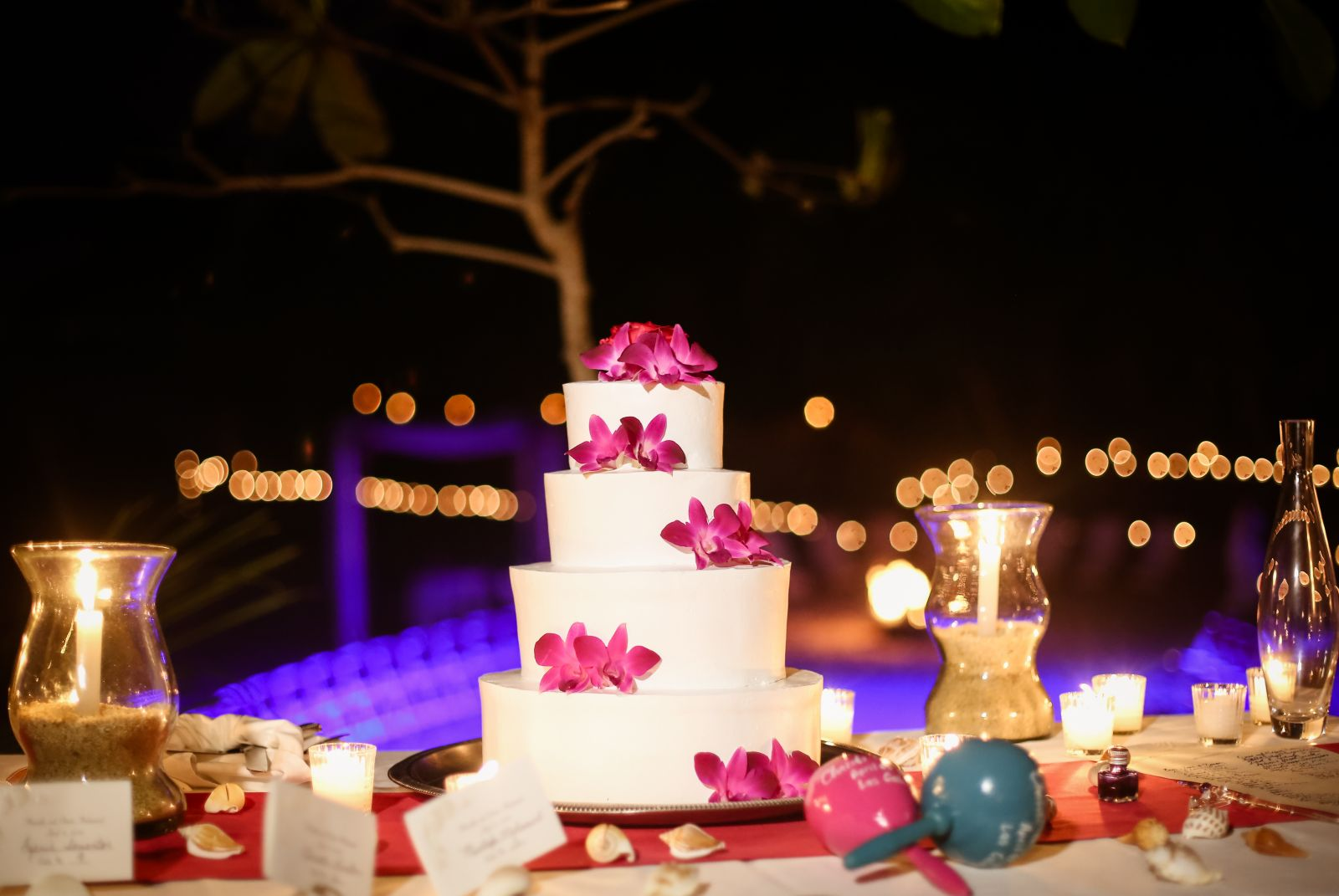 spectacular wedding cake with pink orchids