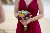 bridesmaid in red and beautiful bouquet