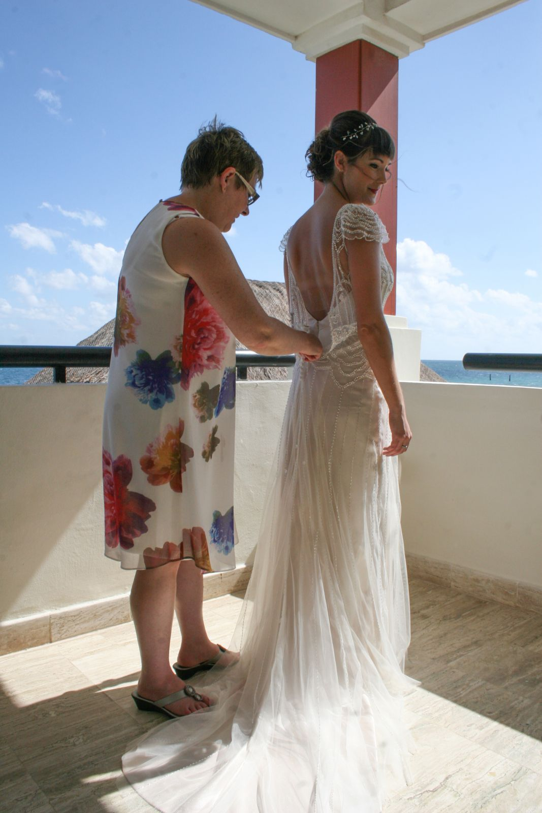 Mom helping me with my Dress