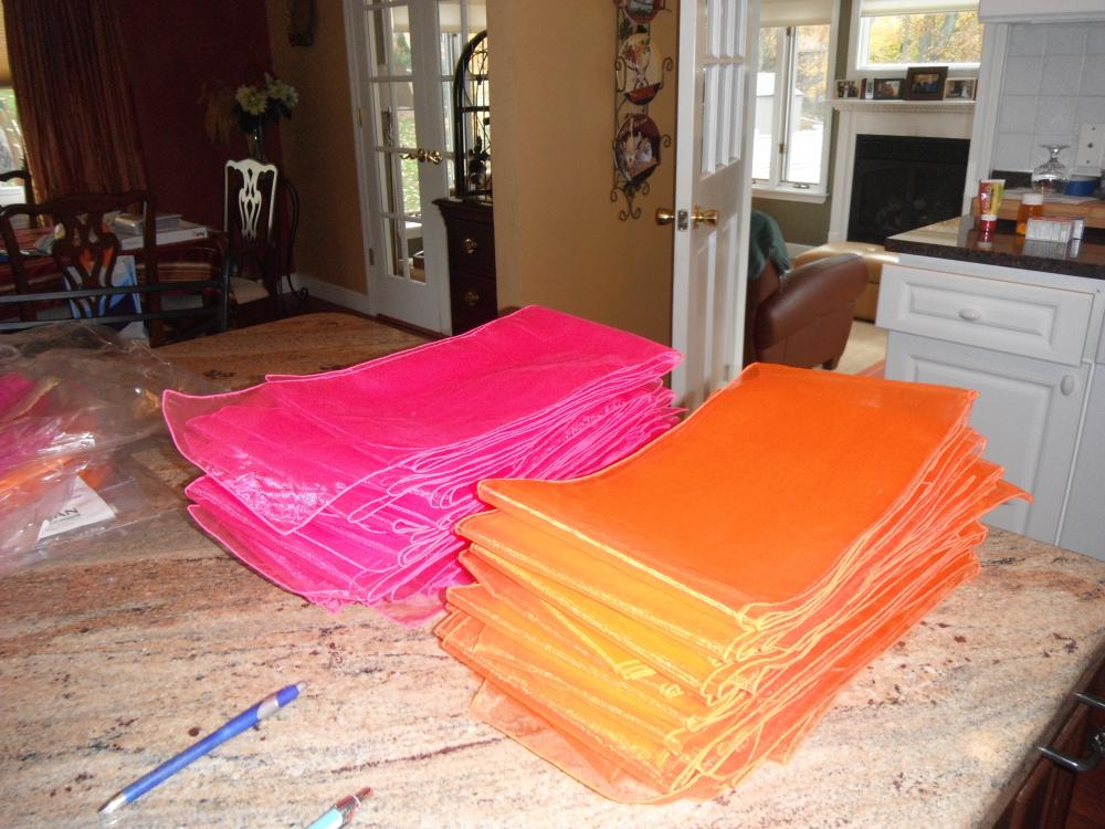 Cleaning out after orange/fushia wedding Sashes, lanterns, flip flops, first aid kits, starfish, etc.