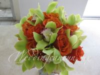 orange and green bouquet. Combination of roses and cymbidium orchids.