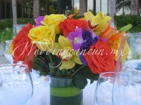 roses, lilies, cymbidium orchids, lisianthus and dendrobium orchids colorful centerpiece