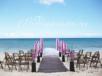 modern beach ceremony with fiucsa and chocolate color aisle decor