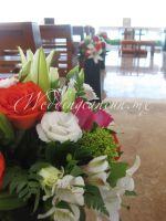 combination of fiucsa, white, orange and green flowers for aisle decor