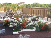 monumental  centerpiece. White orchids and orange lilies in logs