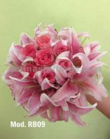 pink oriental lilies and fiucsa roses bouquet