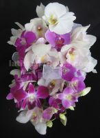 dendrobium, phaleanopsis and cymbidium orchids wedding bouquet in purple and white