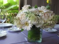 white gerberas, white lisianthus and ivory roses with a touch of green centerpiece