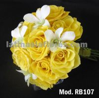 yellow roses and white dendrobium orchids bridal bouquet
