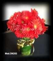 red gerbera daisies centerpiece