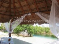 ceremony decor next to the mangrove and river at hacienda tres rios