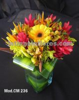 orange alstroemeria, red ginger, bird of paradise, yellow gerbera daisies and lilies with goldenrod wedding centerpiece