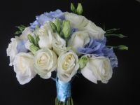 white roses and lisianthus with a touch of blue hydrangeas bouquet