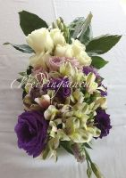 white alstroemeria with purple  roses, lisianthus and white roses centerpiece