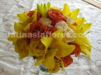 yellow lilies with orange, yellow and ivory roses bouquet